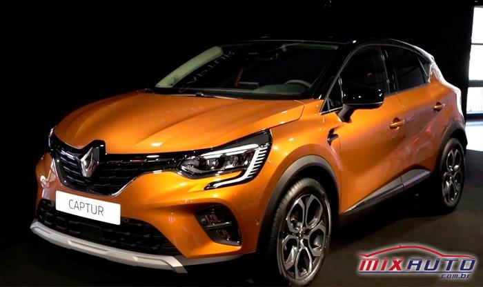 Renault Captur 2021 laranja com detalhes preto parado